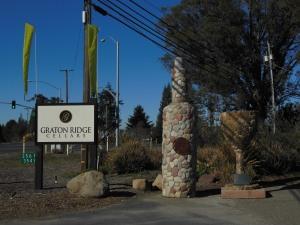 A huge stone wine bottle designates the entrance to Graton Ridge